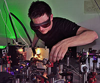Dominik Differt measuring the scattering of light in a rough absorber film. Photo: Bielefeld University