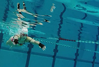 The new system sets changes in water flow pres-sure while swimming into sounds – in real time. Athletes can use this information to hone their own swimming technique. Photo: CITEC/Bielefeld University