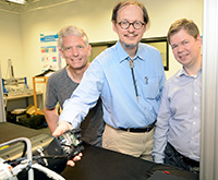 Privatdozent Dr. Sven Wachsmuth, Prof. Dr. Helge Ritter and Privatdozent Dr. Dirk Koester (from left) are developing robot hands that figure out on their own how to grasp and move unfamiliar objects. Photo: Bielefeld University