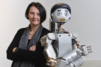 "Prof. Dr. Britta Wrede, from the Cluster of Excellence CITEC, is one of leaders on this project, which networks Floka the robot – pictured here with a ""social head"" – with a smart apartment. Photo: CITEC/Bielefeld University"