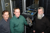 The physicists Professor Dr. Edwin Laermann, Dr. Olaf Kaczmarek, and Professor Dr. Frithjof Karsch (from left to right): Dr. Kaczmarek is holding a graphics board from the new high-performance computer for theoretical physics. The new computer is equipped with 400 modern graphics boards.