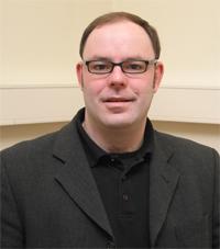 Professor Dr. Markus Schumacher referiert über die Entdeckung des Higgs-Teilchens.