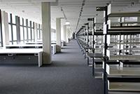 Ruhe vor dem Sturm: Tausende Regalmeter und 350 Arbeitsplätze warten im Gebäude X auf die Nutzer.