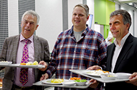 Günther Remmel (Managing Director of the Association for Student Affairs-Bielefeld), Christian Osinga (Chairman of the Administrative Board of the Association for Student Affairs-Bielefeld) and Prof. Dr. Gerhard Sagerer (Rektor of Bielefeld University) were some of the first to try out the new canteen. Photo: Bielefeld University.