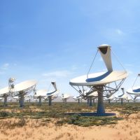 The SKA will be a collection of thousands of radio receivers and dishes spread across two sites in South Africa and Western Australia. Simulation: SKA Organisation