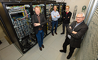For the de.NBI, they are coordinating computing power and services for bioinformatics in Germany (from left to right): Professor Dr Andreas Tauch, Professor Dr Alexander Sczyrba, Professor Dr Jens Stoye, and Professor Dr Alfred Pühler. Photo: Bielefeld University/M.-D. Müller