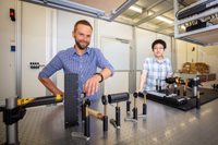 In the new study together with their international colleagues, Professor Dr Dmitry Turchinovich (left) and Wentao Zhang demonstrate how the ultrafast change of magnetic states can be measured. Photo: Bielefeld University/M.-D. Müller